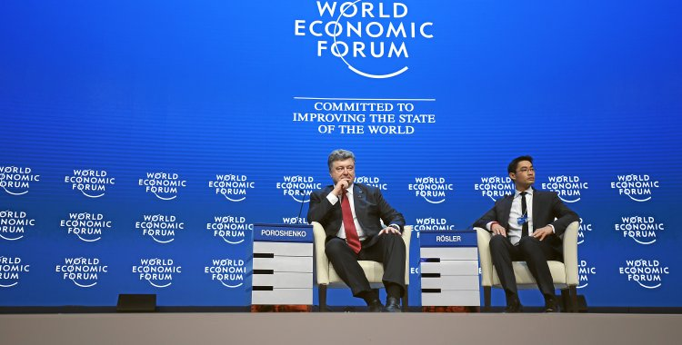 Jolanda Flubacher: DAVOS/SWITZERLAND, 21JAN15 - Petro Poroshenko, President of Ukraine and Philipp Roesler, Head of Centre for Regional Strategies, Member of the Managing Board, World Economic Forum; Young Global Leader are captured during the plenary session 'The Future of